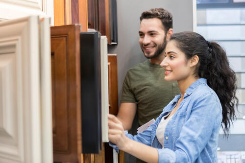 Couple choosing cabinets