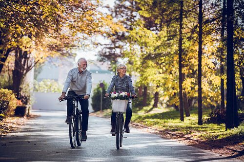 Couple bike riding in the fall