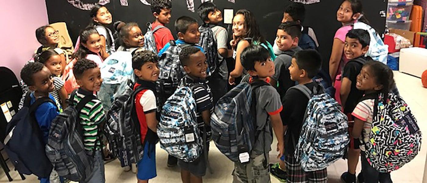 EYA Foundation donates school supplies to Montgomery Housing Partnership
